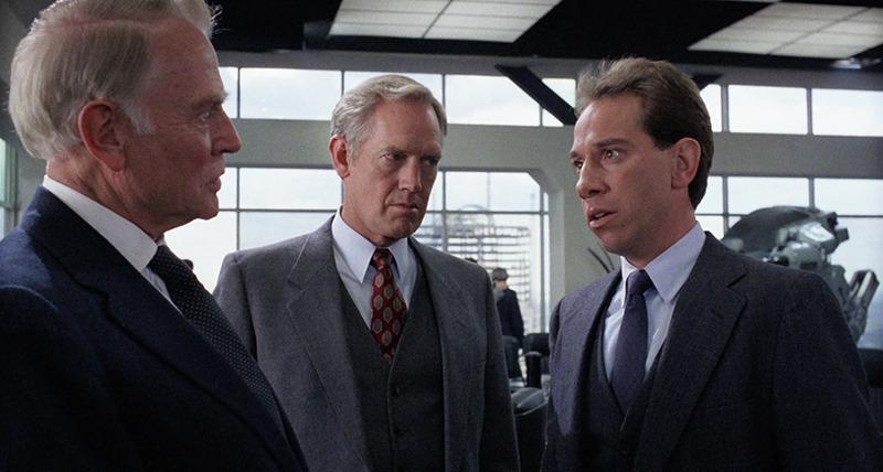Dan O'Herlihy, Ronny Cox y Miguel Ferrer. (Robocop. Orion Pictures. 1987.)