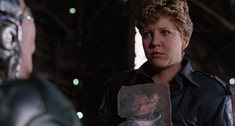 Nancy Allen y Peter Weller. (Robocop. Orion Pictures. 1987.)