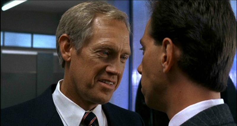 Ronny Cox y Miguel Ferrer. (Robocop. Orion Pictures. 1987.)